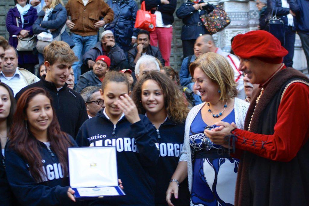 Chiostri-2013-volantino-frontespizio-1024x712  Chiostri-2013-volantino-interno-1024x707  CHIOSTRI-2013-LAVAGNA  Chiostri-2013-Colombo_CorteoStorico_-IlSecoloXIX  CHIOSTRI-2013-BOLIVIA-Morenada-in-vico-dritto-Ponticello-1024x683  CHIOSTRI-2013-BOLIVIA-in-Ponticello-1024x683  Chiostri-2013-3-Sbandieratori-Alfieri-delle-Terre-Stesi-in-fila-indiana-sul-marciapiede...  CHIOSTRI-2013-a-piedi-sul-marciapiede...-1  Chiostri-2013-peruviani-in-fila-per-De-ferrari-1-1024x683  Chiostri-2013-BOLIVIA-Repubblica-boliviani  Chiostri-2013-trasferimento-obbligato-a-piedi-sul-marciapiede...-001  Chiostri-2013-Astesi-in-arrivo  Chiostri-2013-BOLIVIA-sulle-strisce-pedonali  CHIOSTRI-2013-ANSA-Boliviani-sulle-strisce-con-Vigili-a-controllare-il-resto-del-corteo-che-sta-arrivando...  Chiostri-2013-peuviani-a-Ponticello  Chiostri-2013-I-SONAGLI-in-mezzo-alla-folla  Chiostri-2013-Sestrese-a-De-Ferrari  CHIOSTRI-2013-Civitas-Nauli  Chiostri-2013-Morenada-e-alle-spalle-Le-Braide-1024x683  Chiostri-2013-BOLIVIA-Boliviani-a-De-Ferrari-Wagner-Gutierrez  Chiostri-2013-Astesi-a-de-Ferrari-1024x683  Chiostri-2013-foto-La-repubblica-Braide  Chiostri-2013-Stefania-Fiore  CHIOSTRI-2013-Susa-etc-da-REPUBBLICA-1024x683  Chiostri-2013-studenti-del-Nautico-San-Giorgio-1024x795  Chiostri-2013-Sonagli-3  Chiostri-2013-Semilleros-1024x827  CHIOSTRI-2013-La-Compagnia-dellUnicorno-davanti-alla-Chiesa-del-Gesù  Chiostri-2013-SONAGLI-DOC-a-Matteotti  CHIOSTRI-2013-Marco-Federici  CHIOSTRI-2012-pubblico-a-San-Lorenzo  Chiostri-2013-studentessa-legge-atto-notarile  CHIOSTRI-2013...-Studenti-ITN-San-Giorgio-con-professore-e-bandiera  Chiostri-2013-NAUTICO-grande-soddisfazione-dei-ragazzi-e-delle-ragazze-del-Nautico-1024x683  Chiostri-2013-Nautico-e-Cristoforo-1024x695  Chiostri-2013-Nautico-Falduto-e-Cristoforo-1024x683